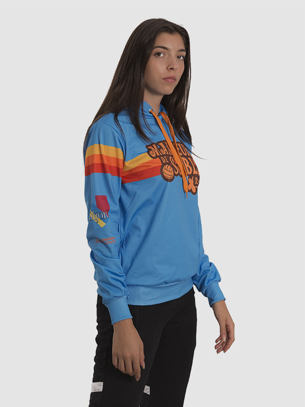 A female model wearing a blue custom-made hoodie. Fabric is polyester, printing technique is dye sublimation.