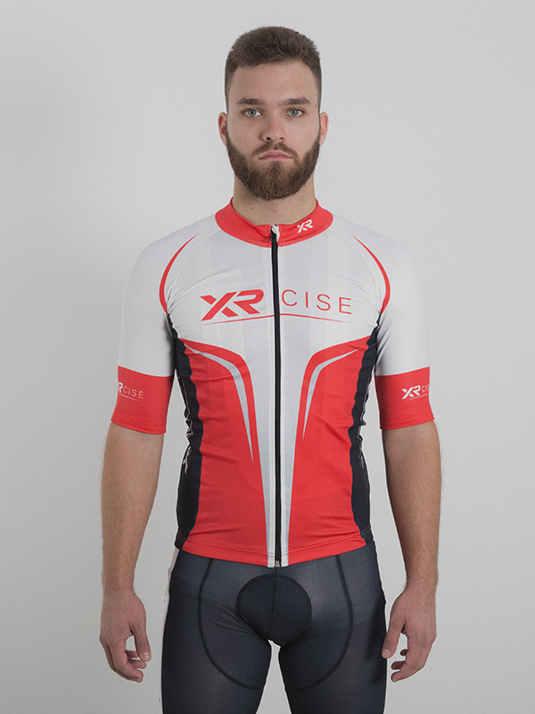 A male model wearing a red polyester long sleeve cycling top. Color is applied using dye sublimation printers. Front is shown