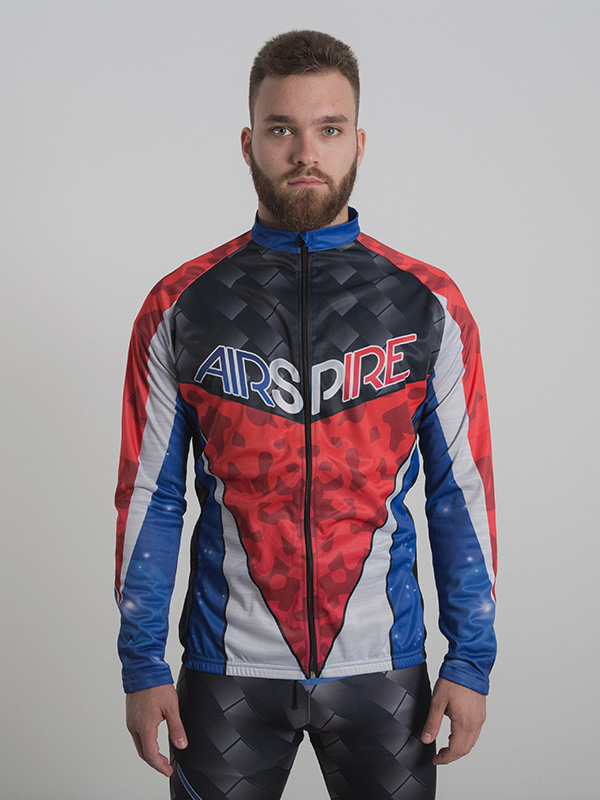 A male model wearing a custom-made tri-color long sleeve cycling top. The brand logo is printed on the chest area.
