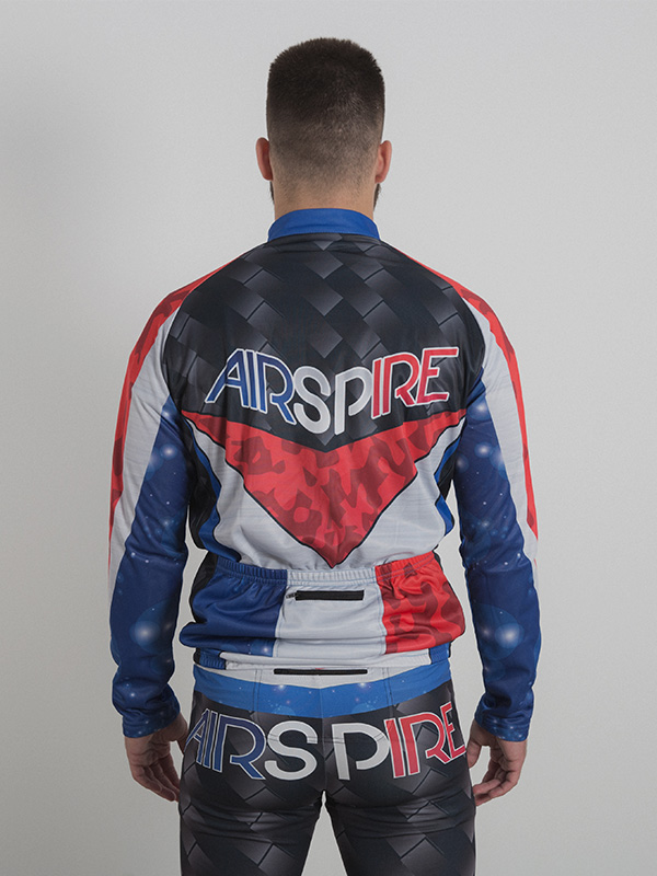 A male model wearing a custom-made tri-color long sleeve cycling top. The back side of the cycling top is shown.