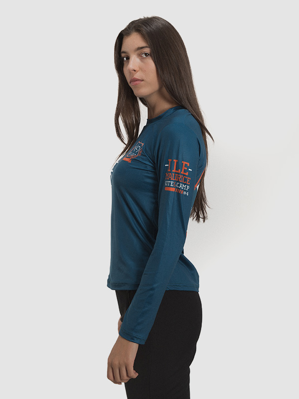 A female model wearing a long-sleeved peacock blue kite surfing jersey. Left side is shown.