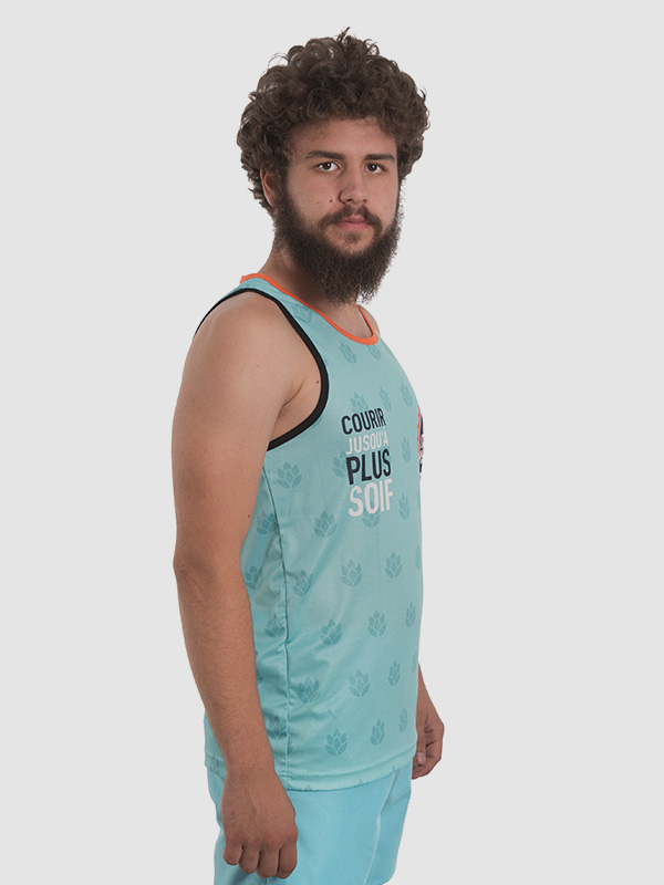 A male model wearing an all-over dye sublimated turquoise tank top.