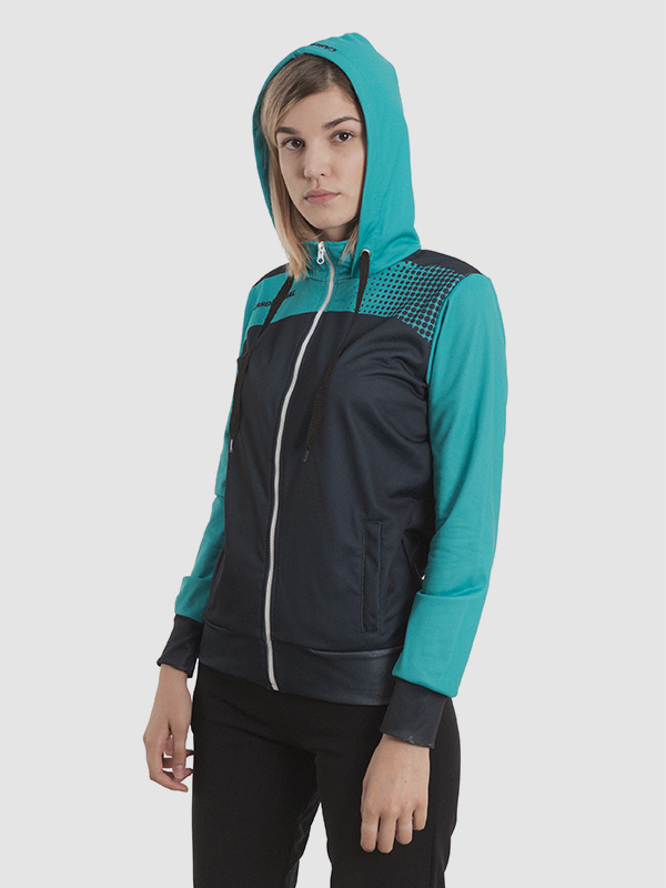 A female model wearing a hooded cyan and black tracksuit.