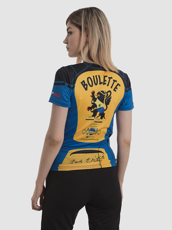 Cycling top sublimation printing made by FUSH. The photo shows a female model photographed from the back to show the sublimation printing used on this garment.