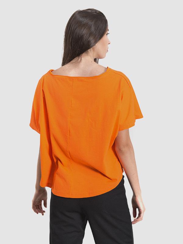 A female model wearing an orange zumba t-shirt. Back side is shown.