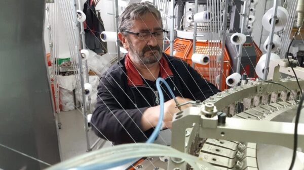 Milovan Ristic Knitting Expert from FUSH Working on a Knitting Machine