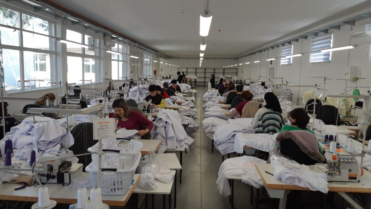 Photo of sewing technicians working in the FUSH clothing factory in South-Eastern Serbia