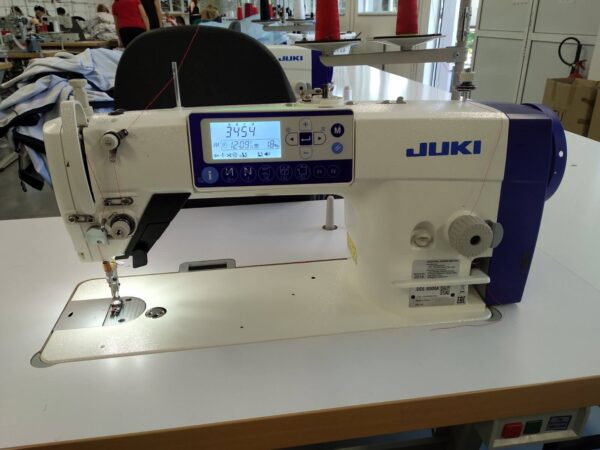 JUKI DDL 8000A loctstitch sewing machine in a clothing factory