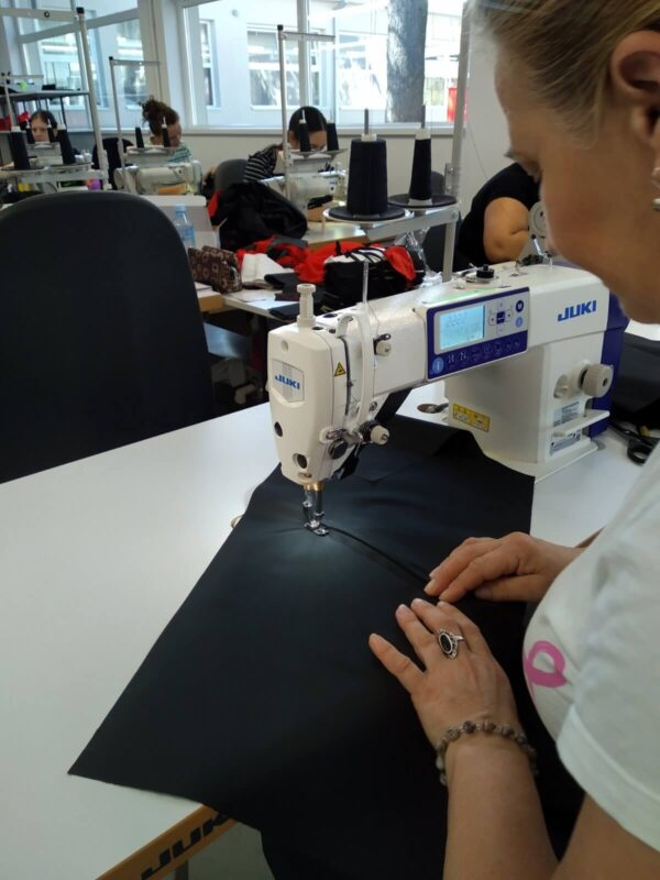 JUKI DDL 8000A loctstitch sewing machine used by an operator in a clothing factory