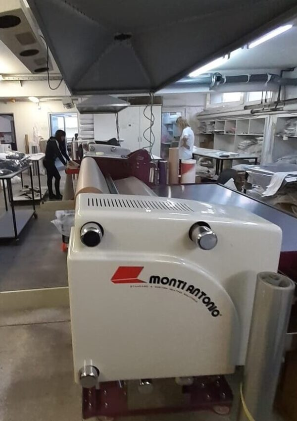 Monti Antonio T120 heat calander for dye sublimation at a clothing factory.
