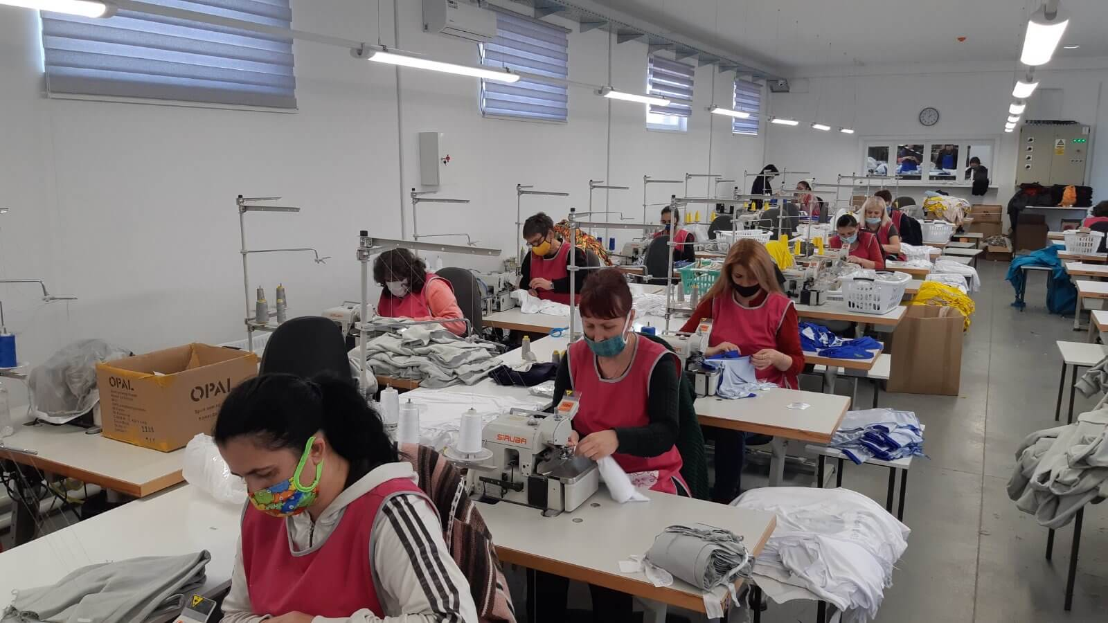 Sewing technicians working in a European clothing factory.