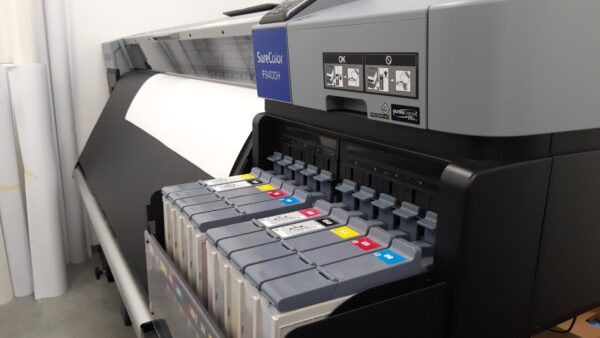 Cartridges from the Epson SureColor F9400H fluo dye sublimation printer at the FUSH clothing factory