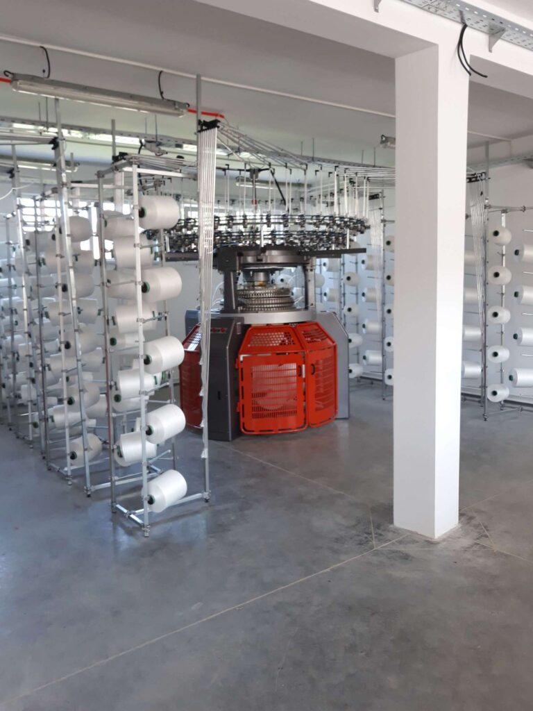 Canmartex circular knitting machine in a clothing factory