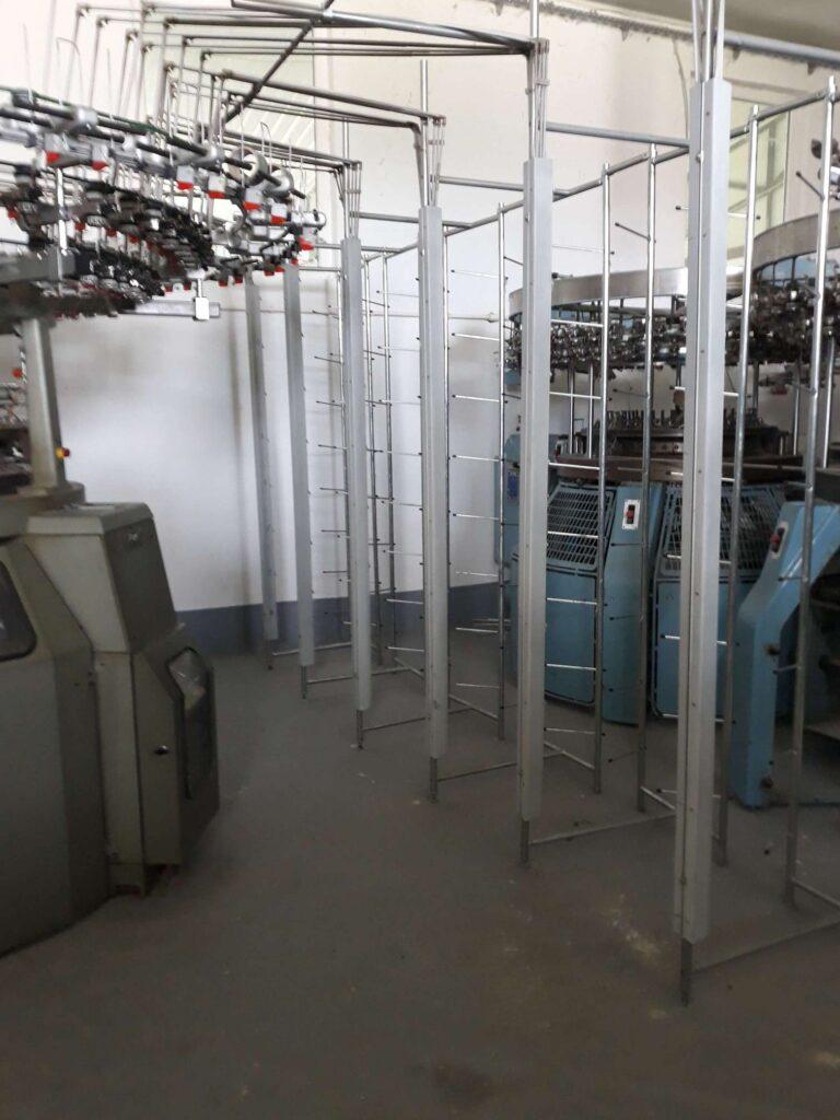 Various circular knitting machines at the garment manufacturing location.