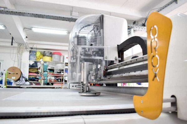 Closeup of the Orox Flexo CNC fabric cutting machine.