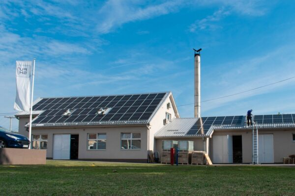 Image of two buildings with solar panels